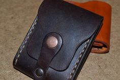 Beautiful and practical mini wallet made from full grain leather. Perfect for credit cards and folded bills. Closing of a button. If you do not like big wallets, this wallet for you to find. Wallet is sewn entirely by hand. Mini wallet canhandle the shoe polish is the appropriate color.
