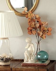 The best coastal fall decorating works in bits of the natural world with a light hand.  Here, a diminutive bunch of autumn leaves plays nicely against sea blue.