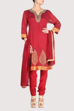 Red suit with neckline adorned with bugle beads and sequence. Shop Now: www.karmik.in/shopping/index.php