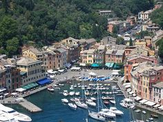 The Colorful Seaside Town of Portofino, Italian Riviera Hot Spot: Pastel Houses Line Portofino Harbor