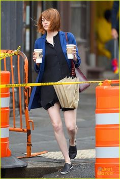 Emma Stone uses her umbrella to shield herself from the rain while heading to a coffee shop on Tuesday morning (September 16) in New York City.