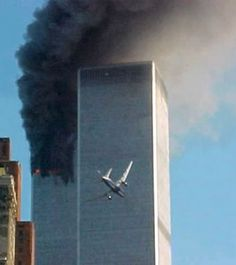 """I don't think anyone will ever forget where they were when and if they viewed this sight, I was sitting there in total shock as I heard the reporter saying, """"It is believed that a plane either had mechanical failure or for some unknown reason deviated off his flight path and one of the twin towers has been hit"""" then all of a sudden the live footage showed the second plane as you see in this photo-just before impact. I immediately yelled out, """"Oh God,all of those poor people. God please-No!"""""""