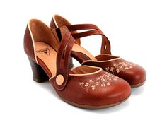 Check out the Fluevog Viardot - I would quite like these too (Also in red with white embroidery - no longer available :(  and White on white as wedding shoes - No that does not mean anything! )