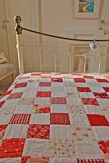 red and white quilt squares like the quilting within the squares.  Looks like a good beginner project.