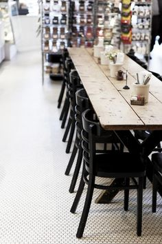 Long table, black chairs, metal retail shelves, and fab tile floor!