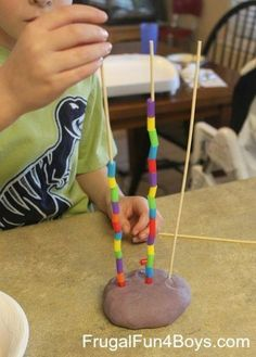 Lace beads or cheerios onto pasta sticking up in play dough! Excellent way to practice fine motor skills!