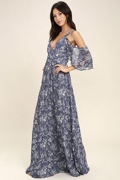 The Good-Hearted Denim Blue Floral Print Maxi Dress will always treat you right! White floral print decorates woven poly as it shapes a princess seamed, surplice bodice, framed by fluttering off-the-shoulder sleeves. Maxi skirt sweeps below a fitted waist. Hidden back zipper.