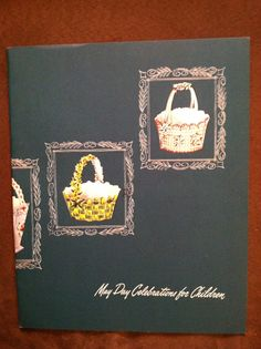 I recently bought a little lot of Hallmark May Basket items.  It included this booklet, May Day Celebrations for Children, copyright 1952.  The baskets on the cover of the booklet are those from what I called Set 1, and two copies of that set were included with the kit, so I'm confident that Set 1 is actually the first set, and that it came out in 1952.