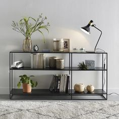 This steel shelf unit is the epitome of neo-industrial chic. Well love the clean lines, sleek geometric design and slender shape, making it a. Living Room Shelves, Living Room Decor, Console Shelf, Tv Shelf, Shelf Display, Steel Building Homes, Low Bookcase, Steel House, Metal Shelves