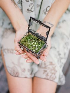 tiny beautiful glass box with moss with wedding rings
