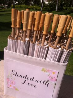 Great way to display your parasols for your guests. Wedding planned by Tori Rogers of Hawaii Weddings by Tori Rogers.  http://www.hawaiianweddings.net