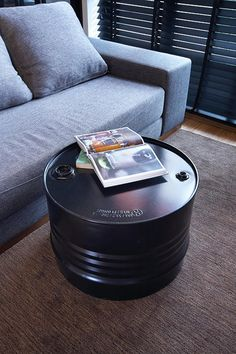 An upcycled oil barrel was customised into a coffee table to blend with the industrial theme.