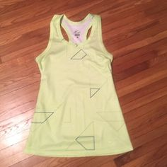 Nike Dri-Fit tank Dri-Fit tank with geometric designs (gray blue & white) racer back tank semi-fitted. Made from 100% polyester. Excellent condition Nike Tops Tank Tops