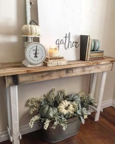 Farmhouse fall. Love the console styling and the neutral pumpkin bucket arrangement :: See this Instagram photo by @the_rusticpallet