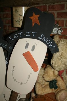 Primitive wooden snowman on a stick, hand made by RNK Primitives.