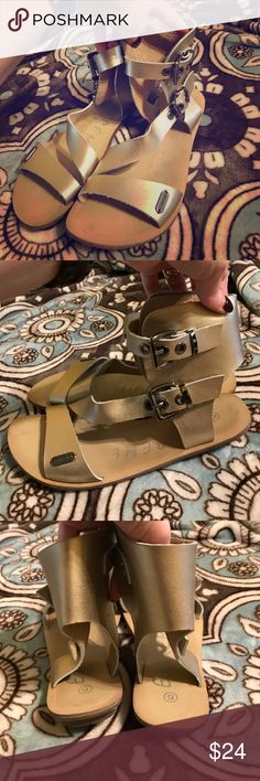 Gold ankle buckle sandals I absolutely LOVE these but they do not fit my tiny ankles! Super soft gold leather. I bought them from my favorite local boutique and wore twice, maybe 3 times. They are just precious! My loss is your gain... Extreme by Eddie Marc Shoes Sandals