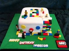 #CAKE!!  LEGO Birthday Cake By sweetscene on CakeCentral.com #LEGO  all edible lego bricks made of fondant, men are real toys, cake covered in fondant, used lego mold to create bricks and inserted into cake! #legocake