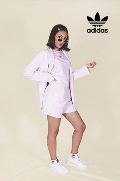 Jasmine wears an all pastel look from the adidas Tennis Luxe collection. A classic tee goes a long way. This adidas t-shirt just made getting ready a whole lot easier. You can dress it up or you can dress it down. Retro Fashion, Adidas Originals, Tennis, Rain Jacket, Windbreaker, Blazer, Casual, Model, How To Wear
