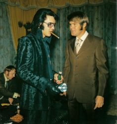 Elvis and Glen Campbell in the Jungle Room at Graceland. Words can't express my love for this photo. His black velvet suit. The cigarillo. The whole thing.