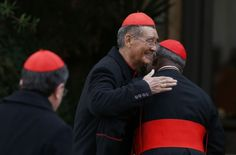 Cardinals Man and Arinze embrace as they arrive for general congregation meeting at Vatican   Cardinal Jean-Baptiste Pham Minh Man of Ho Chi Minh City, Vietnam, embraces Nigerian Cardinal Francis Arinze,  as cardinals arrive for the afternoon session of the general congregation meeting in the synod hall at the Vatican March 7. Cardinal Man, who arrived in Rome March 7, was the last cardinal elector to arrive. (CNS photo/Paul Haring)