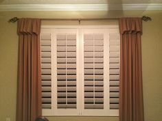 "4.5"" louvers Plantation Shutters with fabric side drapes."