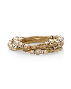 Gilded mesh, golden beads and pavé detailing create a look that is infinitely luxurious and elegant for these fit-all stretch bracelets.  Mesh stretch bracelets; set of 4   Approx. 55mm inner diameter   Soft goldtone; glass crystals   Custom designed exclusively for WHBM. Handcrafted with nickel-free and lead-free metal.