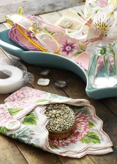 Turn vintage hankies into pretty pockets to hold reading glasses, a compact, or a handwritten note.   http://www.countryhome.com/projects/cooljunk/vintage-fabric-projects_3.html