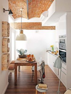 Barcelona apartment- rustic wood cut out & exposed brick in the galley kitchen. Home Interior, Interior Design Kitchen, Interior Architecture, Barcelona Architecture, Apartment Interior, Cozy Kitchen, Kitchen Decor, Urban Deco, Sweet Home