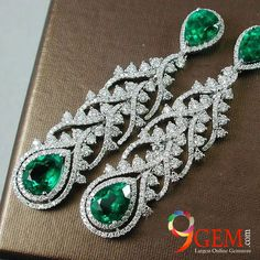 #Style yourself with #glamorous #Emerald #earrings embedded with #diamonds
