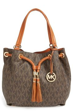Free shipping and returns on MICHAEL Michael Kors 'Large' Gathered Tote at Nordstrom.com. Braided tassels and signature goldtone hardware enhance an easy gathered tote with a modern Michael Kors logo print.