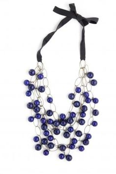 Necklace made ​​of three chains made of bronzes oval rings and large blue pearls, black ribbon closure. Maria Calderara Autumn Winter 2012 Collection.    overall length: 104 cm; length without ribbon: 36 cm.