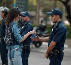 Kendall Jenner, 21, is at the center of backlash for a Pepsi commercial she starred in tha...