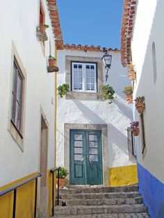 "travelthisworld: "" White, yellow and blue ♦ Obidos, Portugal The Places Youll Go, Great Places, Places To See, Visit Portugal, Portugal Travel, Sintra Portugal, The Beautiful Country, Beautiful Places, Milan Kundera"