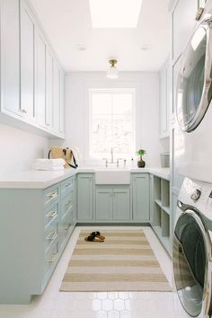 Blue green u-shaped laundry room boasts a beige striped rug placed on white hex floor tiles beneath a skylight. Blue green u-shaped laundry room boasts a beige striped rug placed on white hex floor tiles beneath a skylight. White Laundry Rooms, Mudroom Laundry Room, Laundry Room Organization, Laundry Room Design, White Rooms, Laundry Cabinets, Diy Cabinets, Laundry Room Floors, Small Laundry