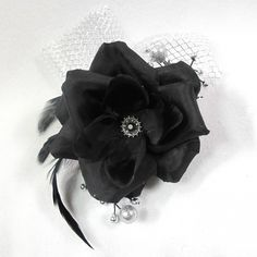 Black and Silver Prom Formal Corsage and Boutonniere SET ($25) ❤ liked on Polyvore featuring jewelry, black silver jewelry, rose flower jewelry, rose jewelry, prom jewelry and black and silver jewelry