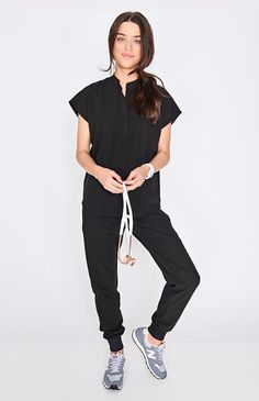 With its clean, draped silhouette, the Rafaela scrub top showcases contemporary shirt features like a mandarin collar and shirttail hem. Womens Fashion For Work, Work Fashion, Fashion Outfits, Housekeeping Uniform, Medical Billing And Coding, Scrub Tops, Mandarin Collar, Scrubs, Normcore