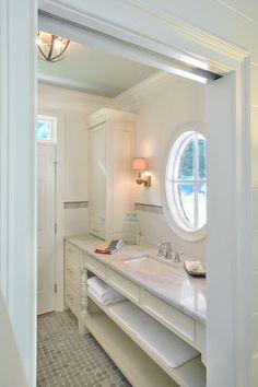 Taj Mahal quartzite with creamy white cabinets