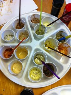 A wonderful idea to paint with spices from The Children's Art Group - great sensory art idea.