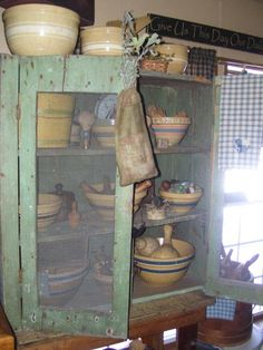 A Vintage cupboard, firkin on old nail keg, filled with rolling pins.  Gorgeous and useful too.  Would this fit in your home?