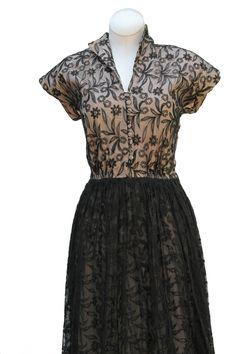 Cabaret Vintage - 1950s Black Lace Cocktail Dress, $325.00 (http://www.cabaretvintage.com/new-arrivals/1950s-black-lace-cocktail-dress/)