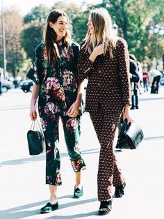 Pajama inspired sets are paired with black flats and handbags.