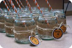 Burlap Wrapped Mason Jars By Craft Gossip for wheat grass or maybe lace wrapped instead or maybe both?
