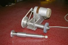 Tool Post Grinder - Homemade tool post grinder featuring replaceable shaftings and pulleys to accommodate different speeds and grinding wheels.