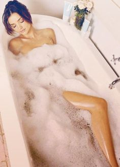 """Miranda Kerr """"I love a long hot peaceful bubble bath, only I would add scented candles all around the tub, to relax the day away."""""""