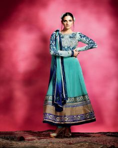 An azure blue ensemble,in pure georgette in with shades of blue floral embroidery and delicate gold work.