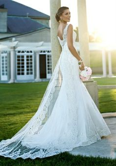 Gown features beading, embroidery, lace, and illusion back.
