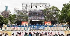 """日本法轮功天国乐团参加了8月29日~30日在名古屋举行的一年一度的大型节庆""""日本正中节""""。参加这次活动的天国乐团成员有两多人。洪大的阵容、震天的鼓乐赢得了观众们的掌声和赞叹,也给以舞蹈为主的节庆活动增添了新的亮点。此外还有来自塞班岛、韩国、台湾等海外团队参加,共207个团队,200多万观众参加了本次""""日本正中节""""。 - 国际新闻"""