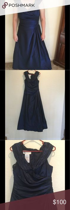 Iridescent dark blue bridesmaid dress Beautiful A line bridesmaid dress. Iridescent dark blue. V neck with embellishment on side.  Crinoline underneath to create full effect. Worn only once and stored in non smoking residence. Size 10 and completely unaltered. Purchased for $300 at Davids Bridal. Style number F23052 David's Bridal Dresses Wedding