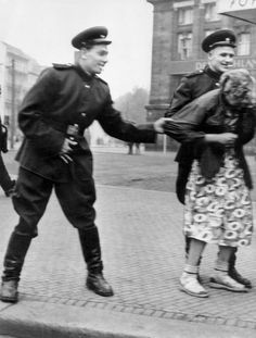 Soviet soldiers openly sexually harass a German woman in Leipzig after the victory of WWII, 1945.