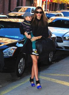 Miranda Kerr Outfit Idea  Every woman should have a classic black dress, with a classic black coat. And just to make it different add a pop of color with the shoes just like Miranda Kerr did it!